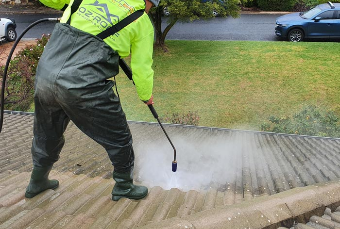 Hi pressure cleaning the roof surface
